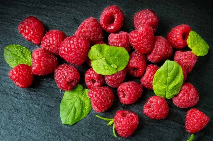 raspberries with green leaves